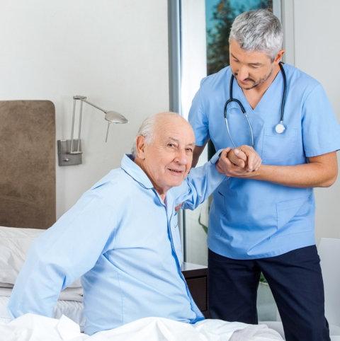 a man helping an elderly man