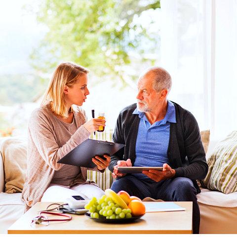 a woman talking to an elderly man