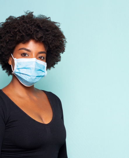 african lady wearing surgical mask