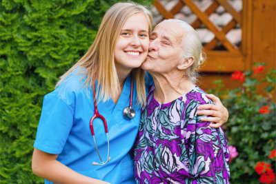 senior woman kissing a caregiver