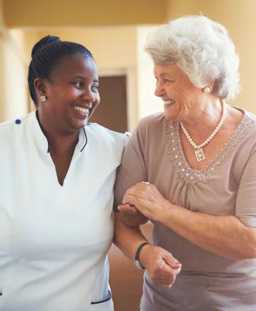 Caregiver and Lady Senior smiling