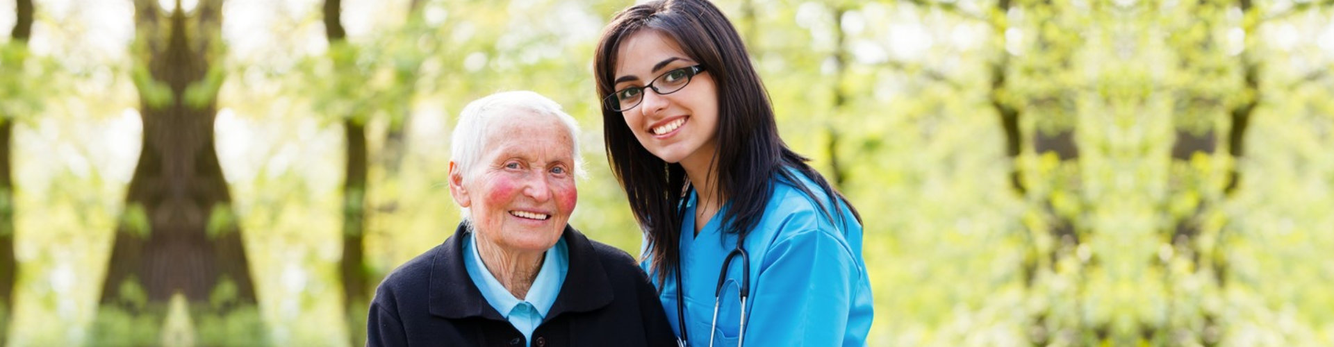 a beautiful woman with a glasses and an elderly woman